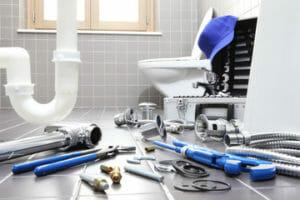 Plumbing tools on a bathroom floor