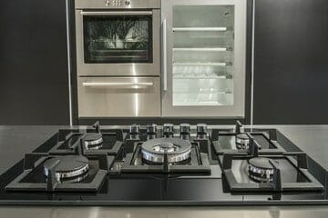 An unlit gas cooktop